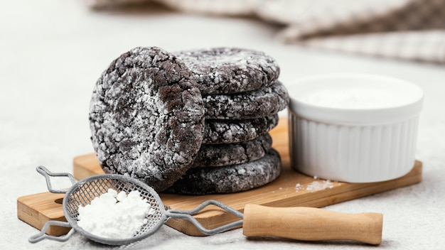 Front view of delicious stacked chocolate cookies with powdered sugar