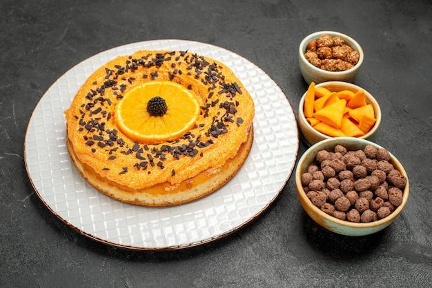 Front view delicious sweet pie with orange slices on dark-grey background pie cake dessert tea cookie