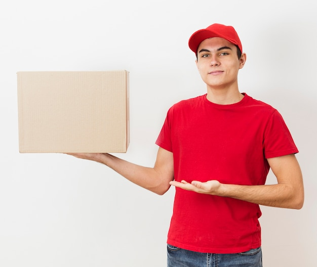 Front view delivery man holding big package
