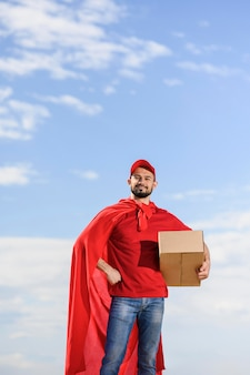 Front view delivery man wearing superhero cape