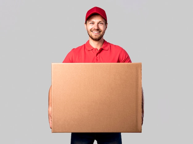 Front view delivery man with box