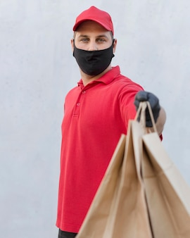 Front view of delivery man with a package
