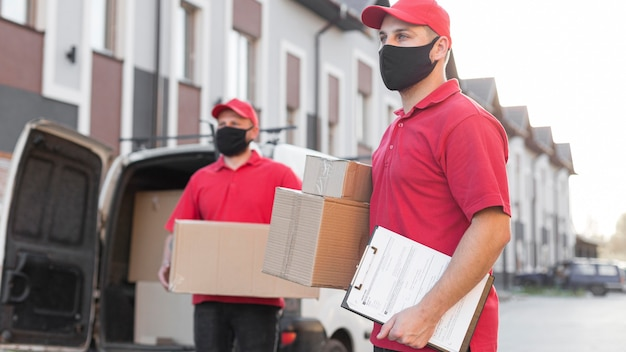 Front view of delivery men with mask