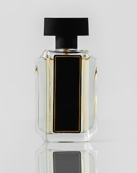 A front view designed bottle on the white wall