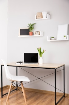 Front view of desk concept with wooden table