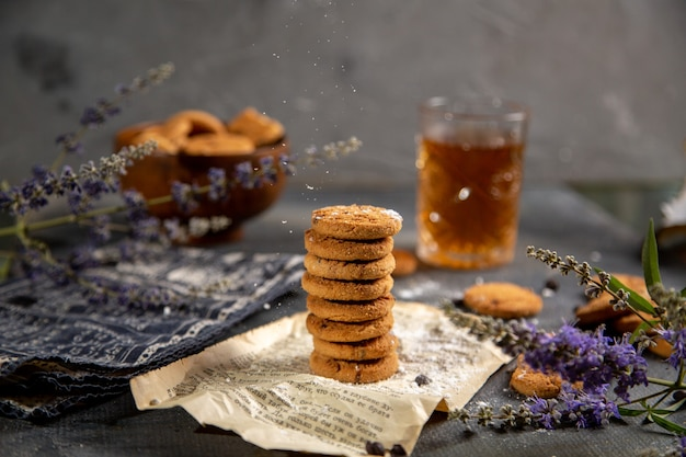 A front view desk with cookies and with tea on the grey table cookie tea biscuit sweet sugar