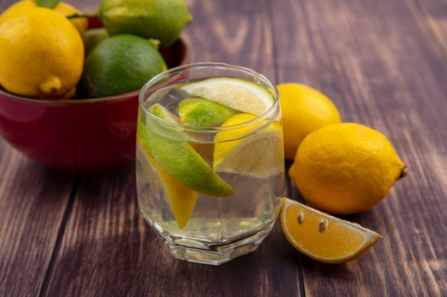 Front view detox water with lemon and lime slices in a glass