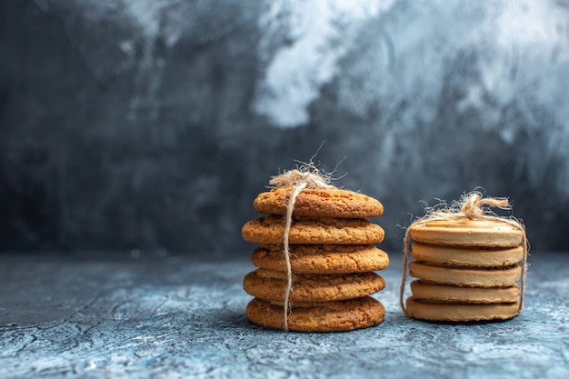 Front view different delicious biscuits on a light background