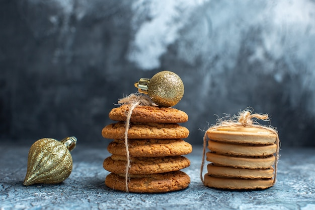 Front view different delicious biscuits on the light background