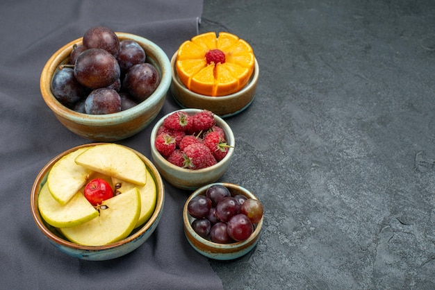 Front view different fruits composition fresh and ripe on dark-grey background ripe fruits health mellow color