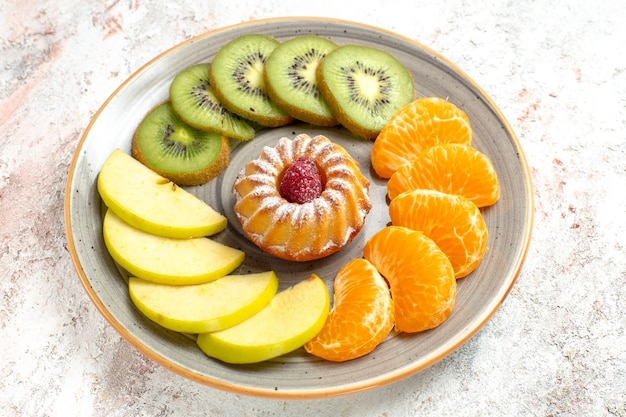 Front view different fruits composition fresh and sliced fruits with cake on white background mellow ripe fruits health
