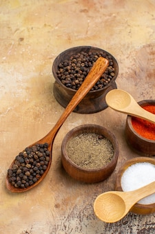 Front view different seasonings on a light desk