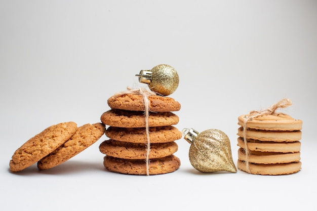 Front view different tasty biscuits on white background