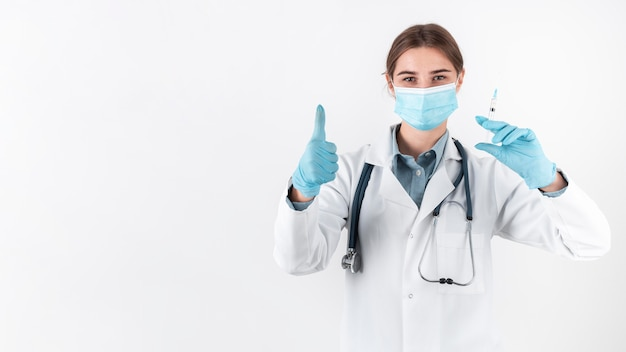 Front view doctor wearing face mask