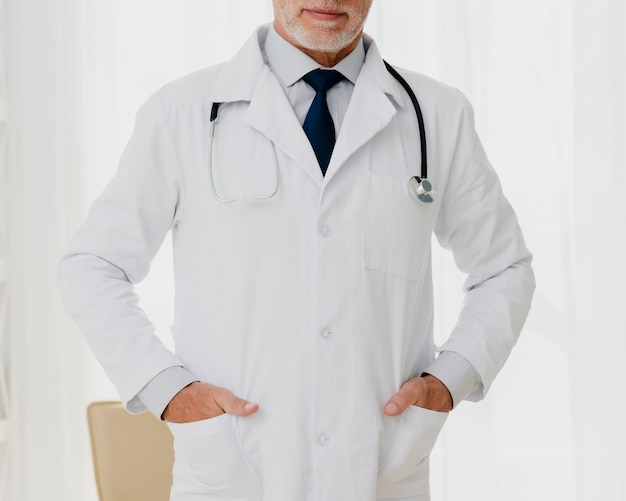 Front view of doctor with hands in pocket
