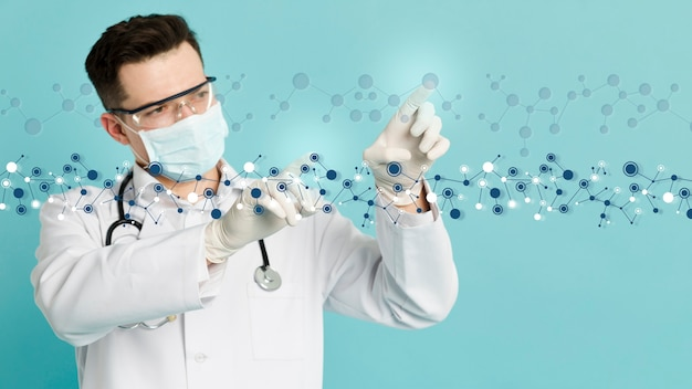 Front view of doctor with surgical gloves analyzing molecular structures