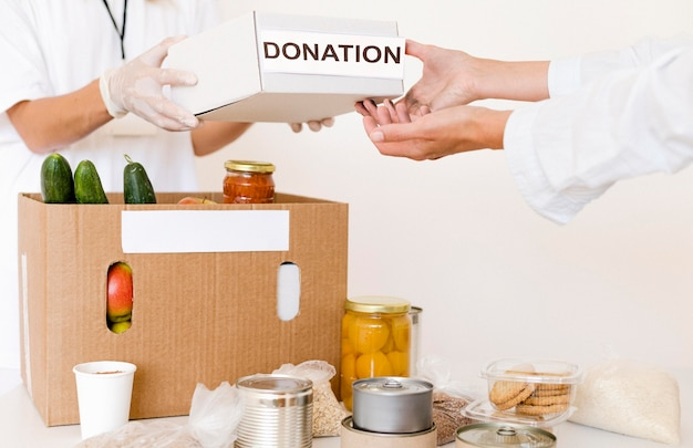 Front view of donation box being prepared with food
