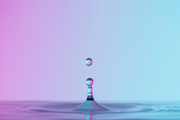 Front view of drops in transparent liquid