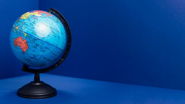 Front view of earth globe with copy space