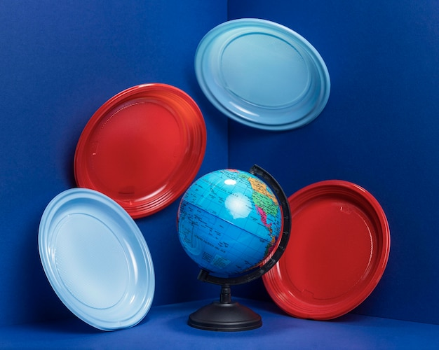 Front view of earth globe with plastic plates