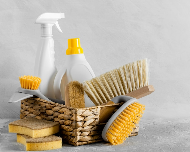 Front view of eco-friendly cleaning brushes in basket with solution