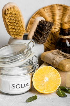 Front view of eco-friendly cleaning products set with lemon and baking soda