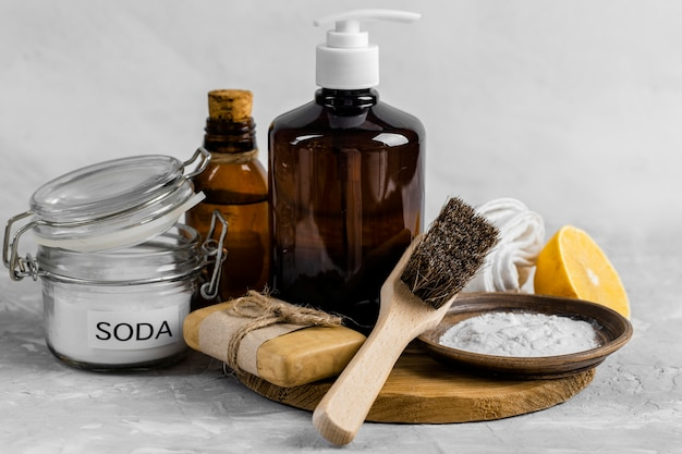 Front view of eco-friendly cleaning products with soap and brush