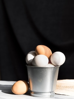 Front view of eggs in bucket with copy space