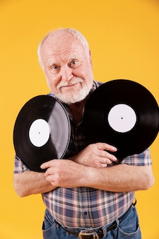 Front view elder man with music records