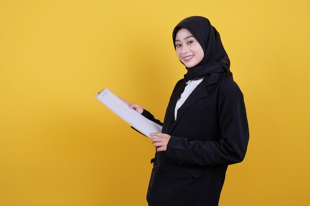 Front view of elegant businesswoman holding clipboard