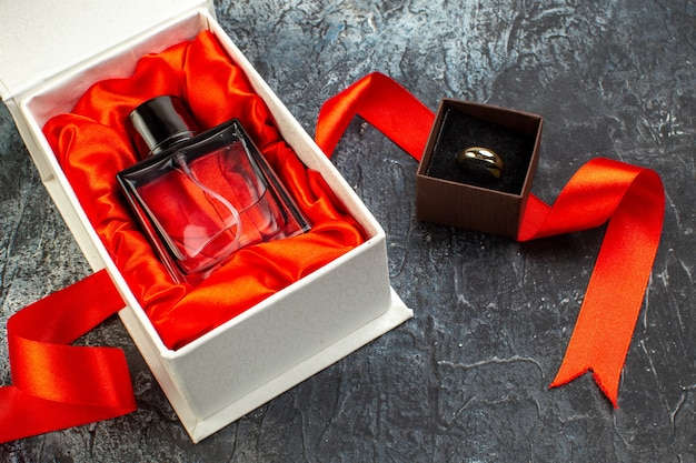 Front view of engagement band perfume in gift box on icy dark