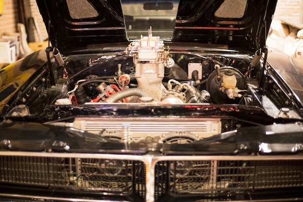 Front view of engine vintage classic retro car at retro garage