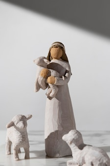 Front view of epiphany day female figurine with sheep