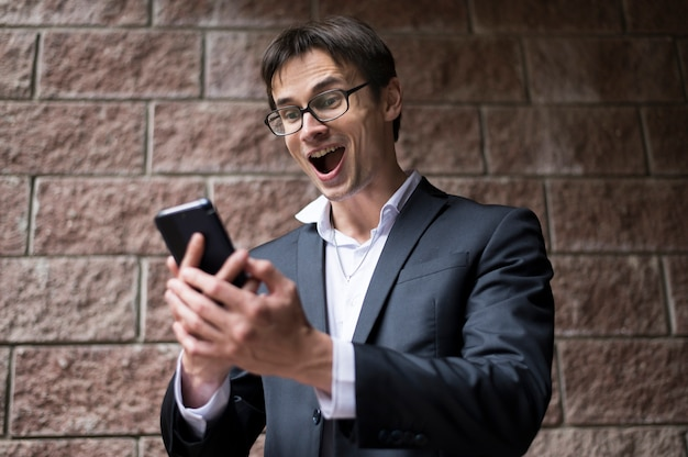 Front view of excited businessman
