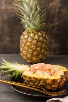 Front view exotic pineapple and shrimps