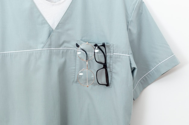 Front view of eye specialist outfit with pairs of glasses