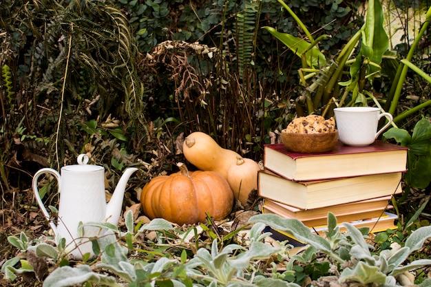 Front view fall season arrangement with pumpkins