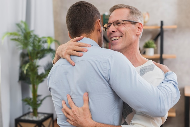 Front view of father and son hugging