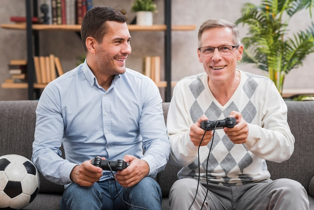 Front view of father and son playing