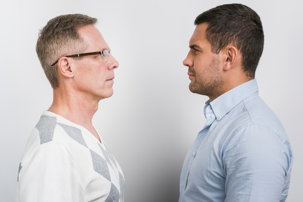Front view of father and son staying face to face