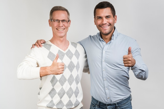 Front view of father and son with thumbs-up