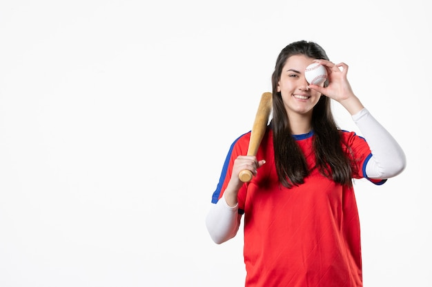 Front view female baseball player with bat and ball