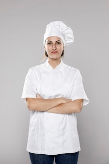 Front view of female chef with crossed arms
