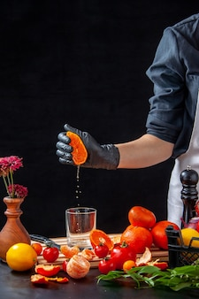 Front view female cook making tangerine juice on gray cooking salad health meal food fruit job diet vegetable fresh drink