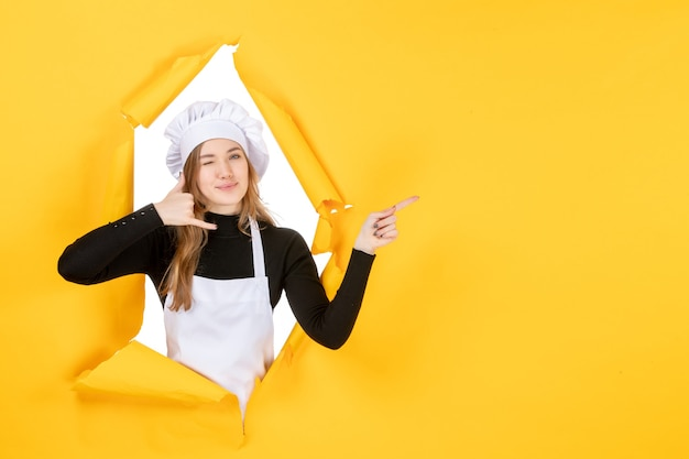 Front view female cook smiling on yellow kitchen photo food cuisine job color paper sun