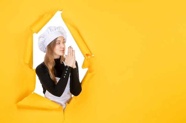 Front view female cook on a yellow sun color paper job photo cuisine emotion food