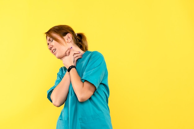 Front view female doctor having breath problems on a yellow space