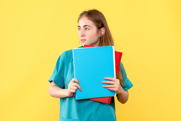 Front view of female doctor with medical notes