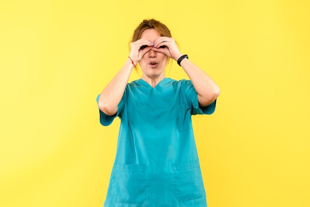 Front view female doctor on a yellow space