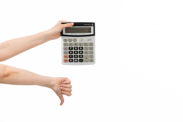 A front view female hand holding calculator showing unlike sign on the white